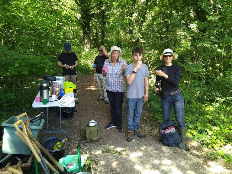 Volunteers having drinks and snacks in the shade