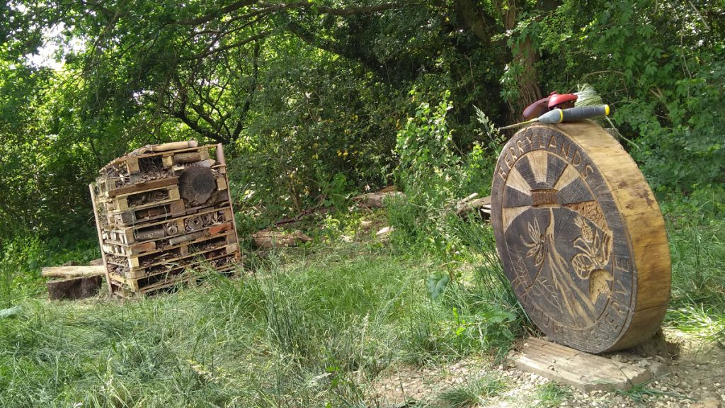 Bug hotel and nature reserve sign