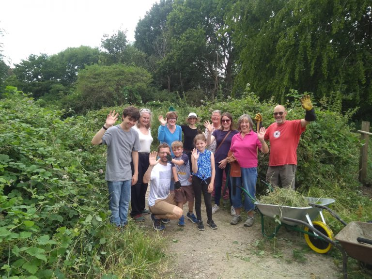 Volunteers posing for a group photo after clearing the path