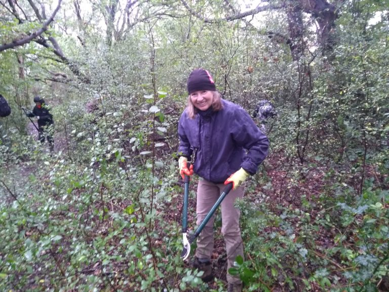 Volunteer posing whihe trimming blackthorn